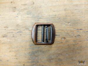 Strap adjuster/slider with movable insert